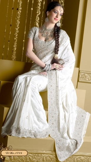 ..keeping it traditional w/the white, but with the intricate indian details! White Khyatee Wedding Saree