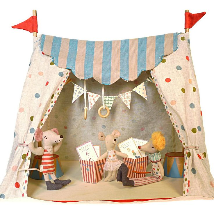 Welcome to the magical Maileg Circus! This trapezoid shape circus tent has a wooden floor board, wooden supporting poles and covered with lovely cotton fabric. 3 delightful circus characters are inclu