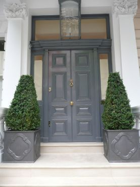 Grey double door. and matching planters. like the color. and like the matching planter idea for the side entrance possibility. gives it more weight.