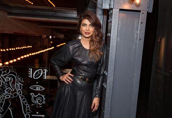 Priyanka Chopra in Backless Black Leather Dress http://rockingpriyankachopra.blogspot.in/2014/01/priyanka-chopra-in-backless-black-leather-dress.html #priyankachopra #dress