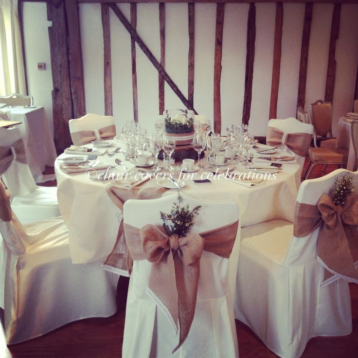 Rustic chair covers, sashes, table runners and centrepiece for www.chaircoversforcelebrations.com
