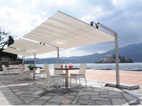 Retractable Patio Awning This Beautiful Patio Awning Has A Retractable  Fabric Awning That Easily Opens And