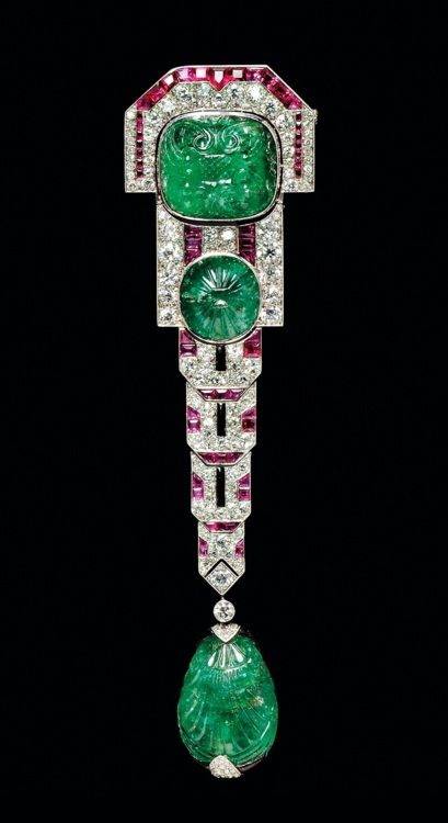 Fine Art Deco carved emerald, ruby and diamond pendant brooch, Chaumet, Paris.