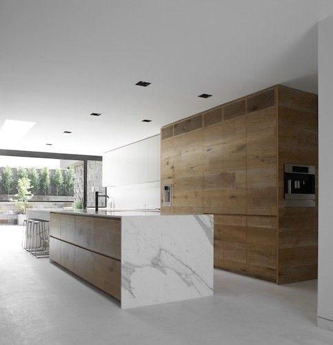 Wood and white marble kitchen inside the Dale project by Australian architects Robson Rak.