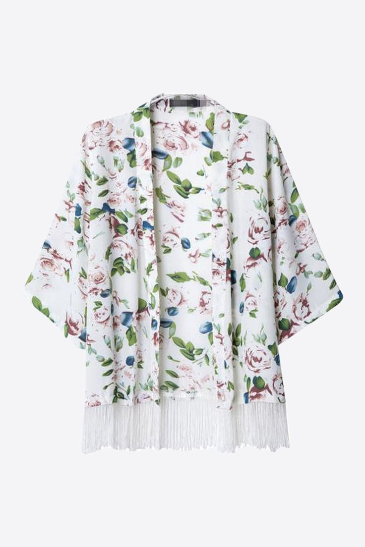 This item is shipped in 48 hours, included the weekends. This kimono with an open front, bold floral print and fringe hem round out this dreamy piece and make it the perfect thing to add a one-of-a-ki