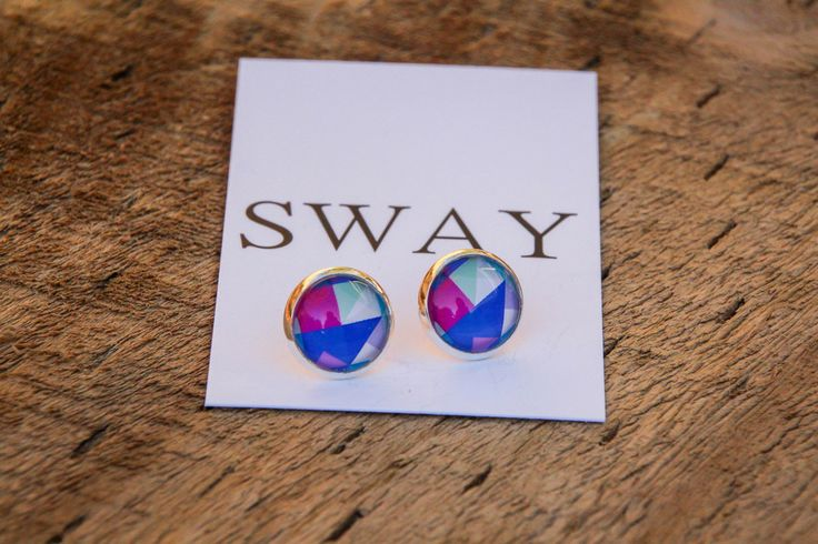 Silver tone stud style earring with multi coloured Geometric print glass stone.