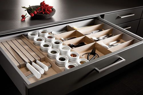 SieMatic kitchen drawer storage. Especially love the wood block for the knives being off the counter.
