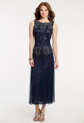 Mesh tea length dress with scallop neckline, beaded fitted bodice, and soft pleated skirt by Pisarro Nights.<br><br>•Scoop neckline<br>•Sleeveless beaded fitted bodice<br>•Mesh pleated skirt<br>•Center back zipper