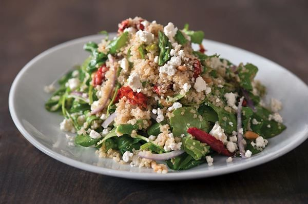Quinoa & Arugula Salad :Super-grain salad with asparagus, sun-dried tomatoes, red onion, toasted pine nuts, and feta tossed in house-made champagne vinaigrette from California Pizza Kitchen Restaurant in Brand Blvd,Glendale #Food #Salad forked.com