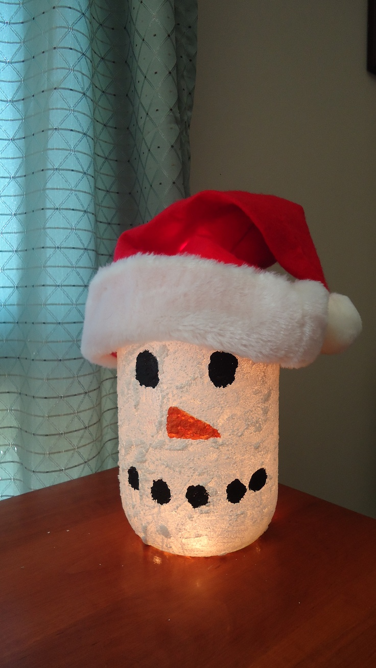 This is a snowman that I made for Christmas.  I use a large glass pickle jar, some snow paint for the whole jar and regular craft paint for the eyes, nose and mouth.  I put a small strand of white lights in the jar and topped it off with a Santa hat!  So easy!