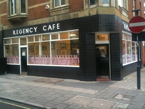 Regency Cafe, Pimlico, London. Old style with the gingham half-curtains on golden rods.