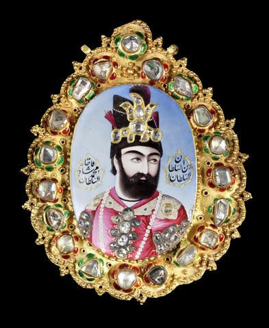 A magnificent, large, diamond-set enamelled gold Portrait of Muhammad Shah Qajar (r. 1834-48) Persia, circa 1835-40,  the oval medallion enamelled in polychrome & inlaid with gold, depicting the Shah with head turned, wearing a crimson robe with pearl-encrusted collar, his turban with an elaborate diamond-set sarpech, the robe with diamond ornaments on the shoulders…set into an elaborate gold frame with diamond-set green & red enamelled flowers; 10.1 x 8 cm. Price realized $187,184