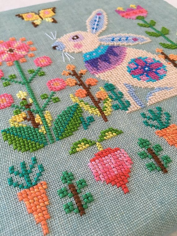 Usher in Spring this year by stitching my modern Easter cross stitch pattern featuring a rabbit in his element: the spring garden! Surrounded by