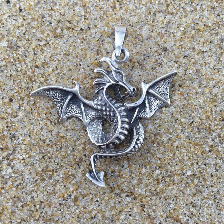 This sterling silver, hand-crafted pendant is 2 inches (5 cm) in length. Reminiscent of old-world mystique, this dragon enhances your warrior spirit.