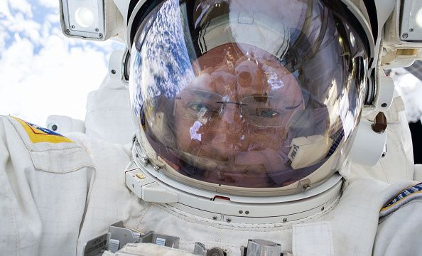 IN SPACE - DECEMBER 21: In this handout photo provided by NASA, NASA astronaut Scott Kelly snaps a quick selfie during a spacewalk on December 21, 2015 in space. NASA astronauts Scott Kelly and Tim Kopra released brake handles on crew equipment carts on either side of the space stations mobile transporter rail car so it could be latched in place ahead of Wednesdays docking of a Russian cargo resupply spacecraft. Kelly and Kopra also tackled several get-ahead tasks during their three hour…