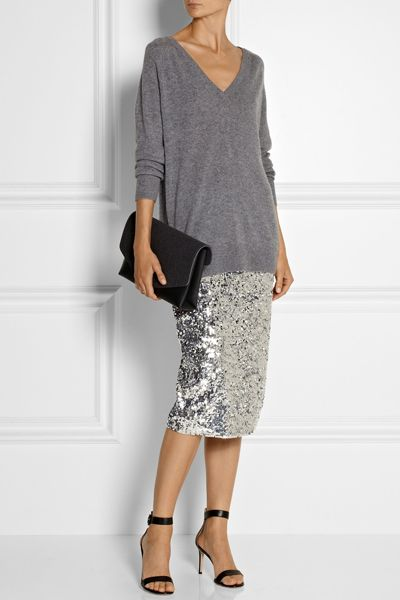sequinned pencil skirt pared down with an oversized sweater, strappy sandals and a clutch bag