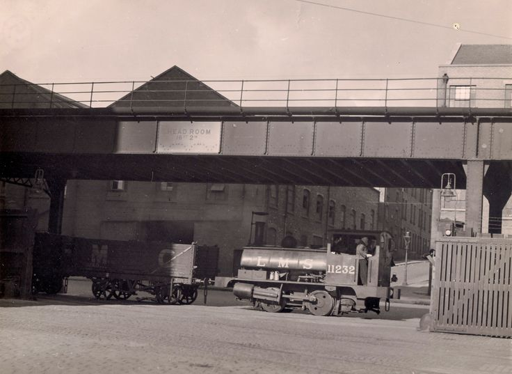 https://flic.kr/p/dDdQqB | Liverpool Pug - with video link | Photographer unknown.  Stephen Wolstenholme collection.  Lancashire and Yorkshire Railway 'Pug' 0-4-0ST number 11232 trundles along Liverpool's dock road underneath the Liverpool Overhead Railway in the 1940s (?).   Can anyone identify the Liverpool location please?   The photograph says Dacre Street (?) on the reverse.  For a recreation of a Pug in a dockland setting, please see the video of a steam charter at Goole docks at…