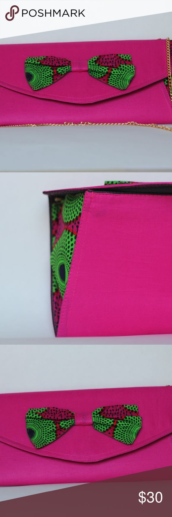 Pink African Purse This purse is 12x14 inches and can be used as a clutch or regular purse, with a strap. It is made of African print, and recycled cardboard. Purse was made in Ghana by a female small business owner. Can be used with a dress, pants or jeans. Bags Clutches & Wristlets