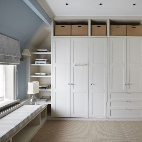 Built in wardrobe closet with sloped ceiling - vary the doors on the alcove in our bedroom