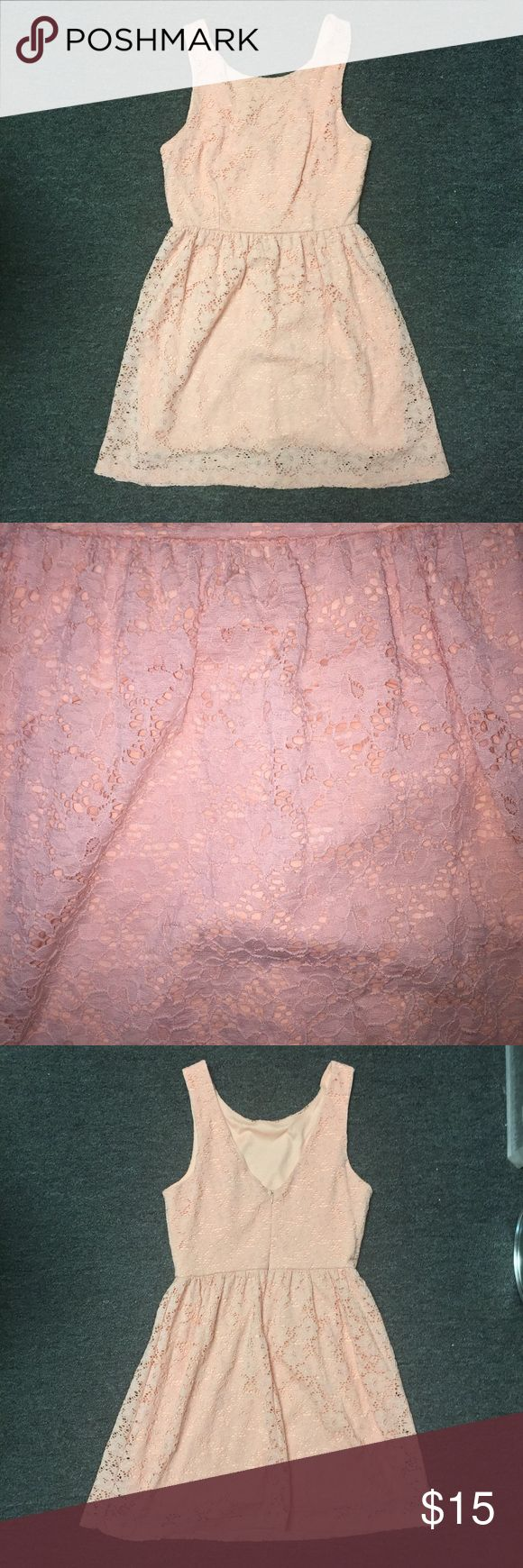Blue Rain Peach Lace Dress with Open Back Blue Rain. Size Large. Zipper down the back. Peach colored Lace dress. Fully lined. Another piece that can easily be transitioned from summer to fall by throwing on a cute oversized Cardigan or jean jacket and some riding boots or even booties. Bust: 18 inches. Length: 35.5 inches. Waist: 14 inches. ALL MEASUREMENTS ARE TAKEN WITH ITEM LAYING FLAT. 95% nylon, 5% spandex. Blue Rain Dresses