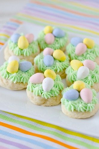 Easter Cookies..my mom does white frosting and then makes a nest of green colored coconut and then puts eggs on it