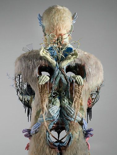 david altmejd, figures made from an assortment of plaster, morphed mannequin parts, animal heads, crystals and birds are  his primary subject.