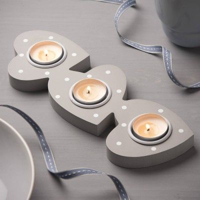 The Grey Spots Wooden Tea Light Holder is a unique tealight holder in the shape of three linked hearts with a lovely painted grey and white spots finish – ideal for Valentine's day!