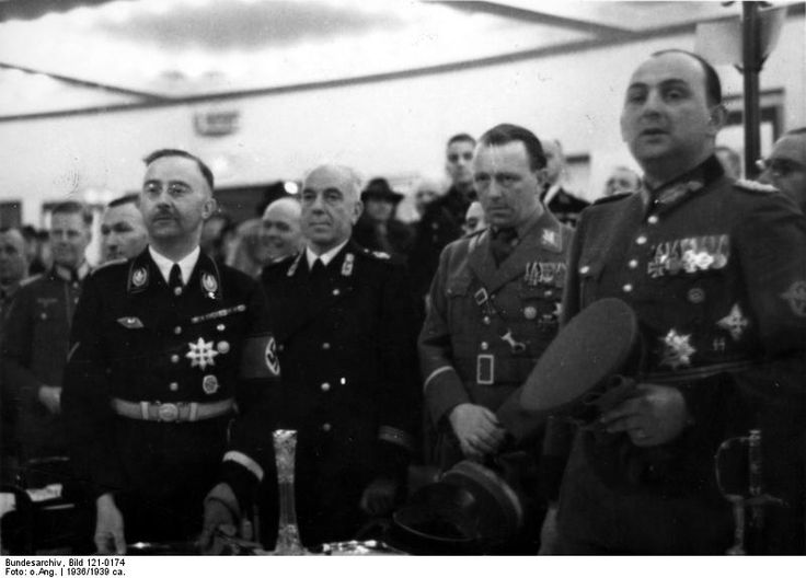 Heinrich Himmler and Berlin police chiefs Wolf Heinrich Graf von Helldorff and Kurt Daluege at a sporting event held in honor of Italian police leaders' visit to Berlin, Germany, 1936.