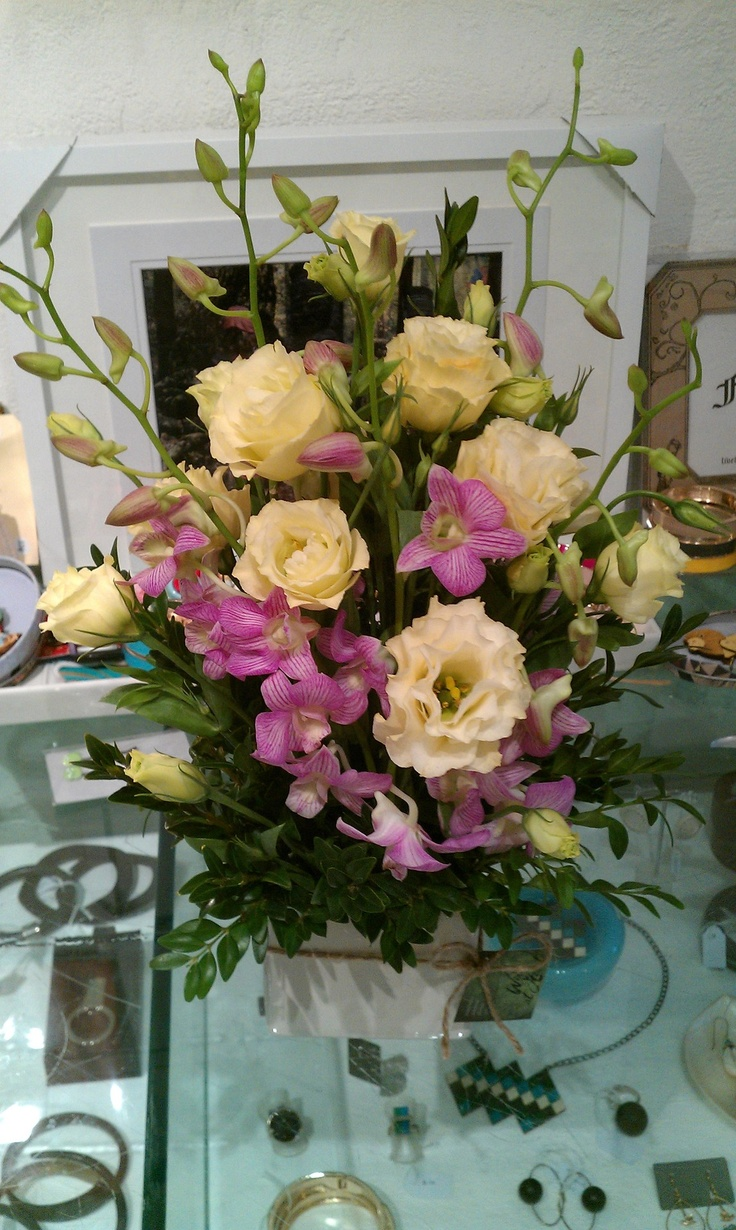 A soft arrangement with pink orchids and cream lisianthus,,,,very pretty!!