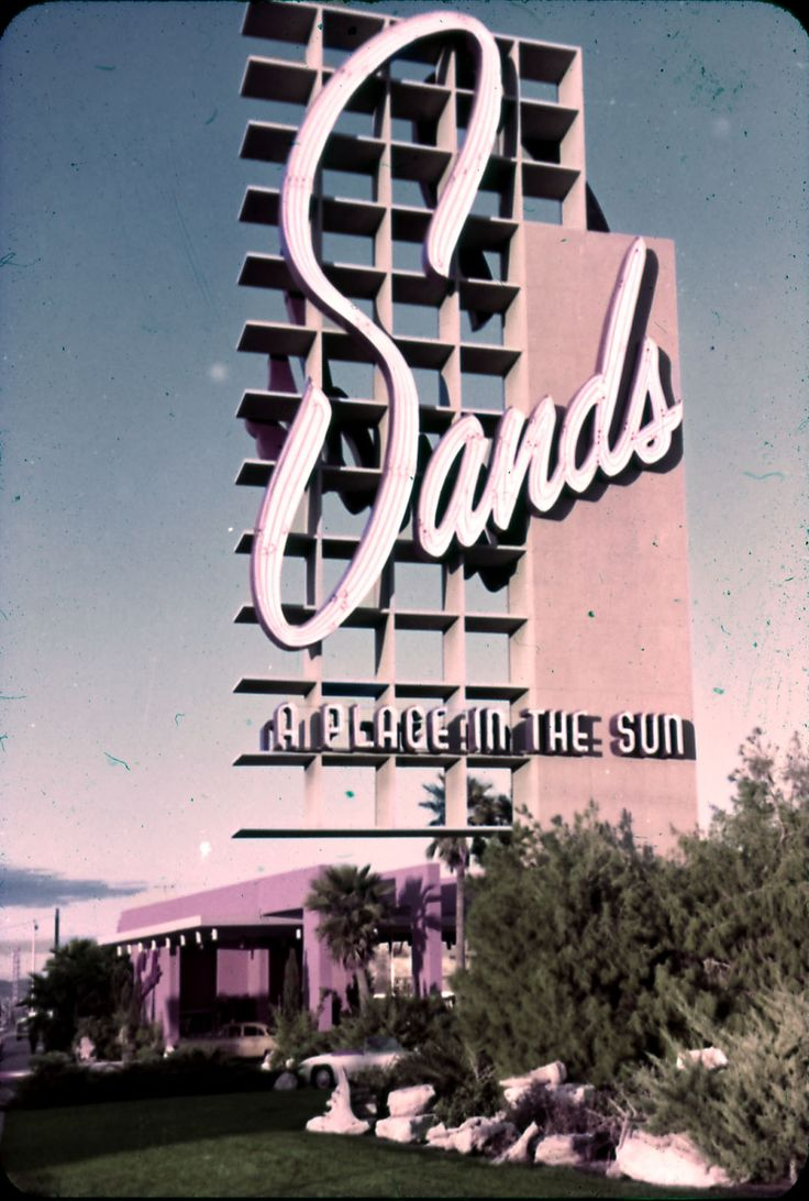 """The neon marquee for Sands Hotel sign that reads """"a place in the sun"""" in Las Vegas, circa 1950s - 1960s.  Part of the UNLV Libraries photo digital collection.  #UNLV"""