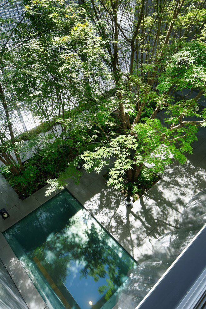 another view of the outdoor space at the Optical Glass House in downtown Hiroshima by Hiroshi Nakamura