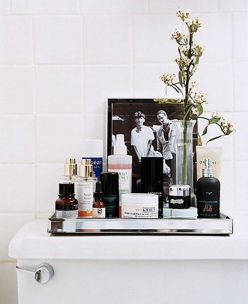 small bathroom - making use of every space, even the top lid