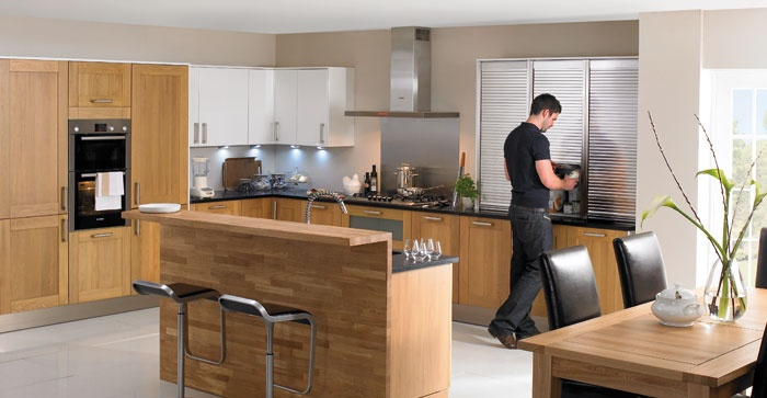 Wren Kitchens - With its lovely warm, light-oak finish and simple, straightforward Shaker style doors, Owen is a design that lends itself to a traditional country kitchen look and feel.