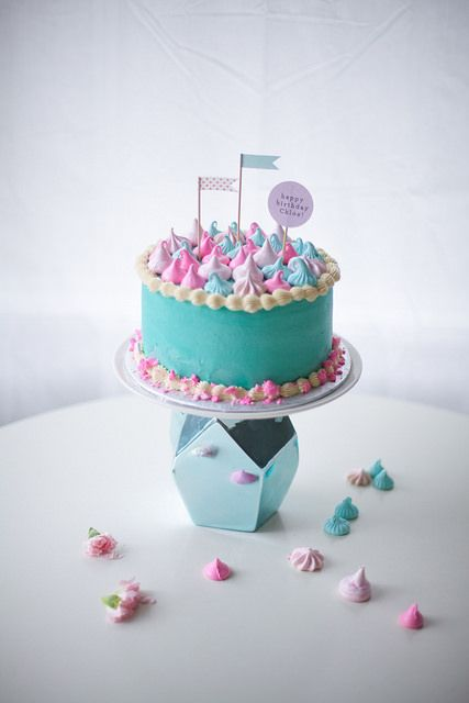 Meringue topped birthday cake in turquoise