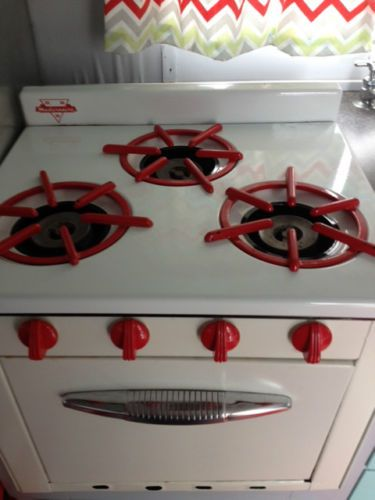 1957 Detroiter 12ft | Cool white stove with red accents! Would love this stove in my 1958 camper