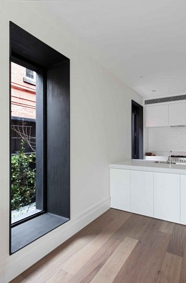 Kitchen with no window coverings
