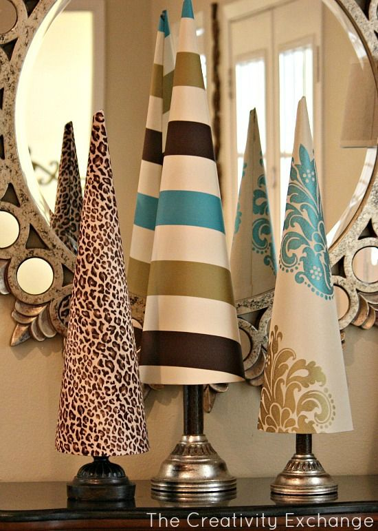 Fabric covered poster board tree cones for the holidays.