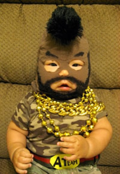 It's a baby.  Dressed as Mr. T.  My husband will DIE!