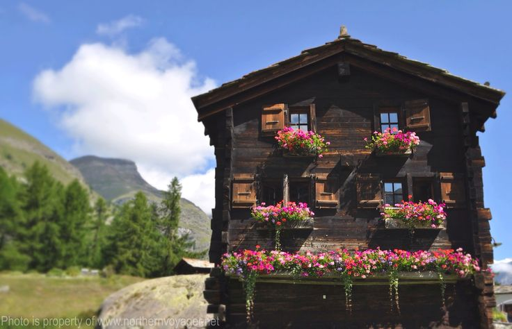 Swiss Chalet Switzerland Travel Alps  Hiking Photography Image Summer Beautiful Rustic Flowers  www.northernvoyager.net Photo by Lee Mailer
