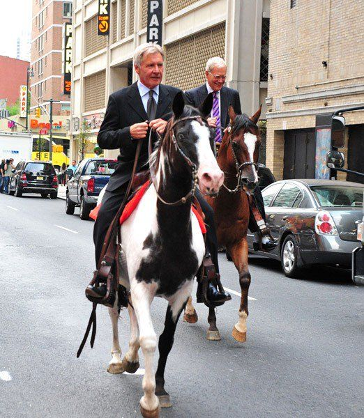 2-David Letterman and Harrison Ford ride horses named Chase and Shane outside the Ed Sullivan Theater on July 18, 2011 in New York City.