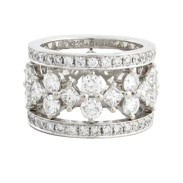 A CAROUSEL OF DIAMONDS  Round and princess cut diamonds take center stage with 2 bands of paved diamonds flanking either side of the diamond ring. (R439)