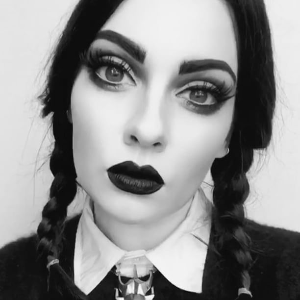 Day XIV in the countdown to Halloween Grown up Wednesday Addams   that lady will always have a little piece of my black soul! ⚔️ @revlon colourstay in Ivory @lorealmakeup true match in N1 @maybelline fit me concealer in Fair @physiciansformula butter bronzer in Light @nyxcosmetics_canada blush in Taupe @katvondbeauty shade&light blush in Paif+Poe @urbandecaycosmetics Naked Flushed highlight in Native @urbandecaycosmetics Gwen Stefani eye pallet and @thebalm_cosmetics Meet Matt(e) Tr...