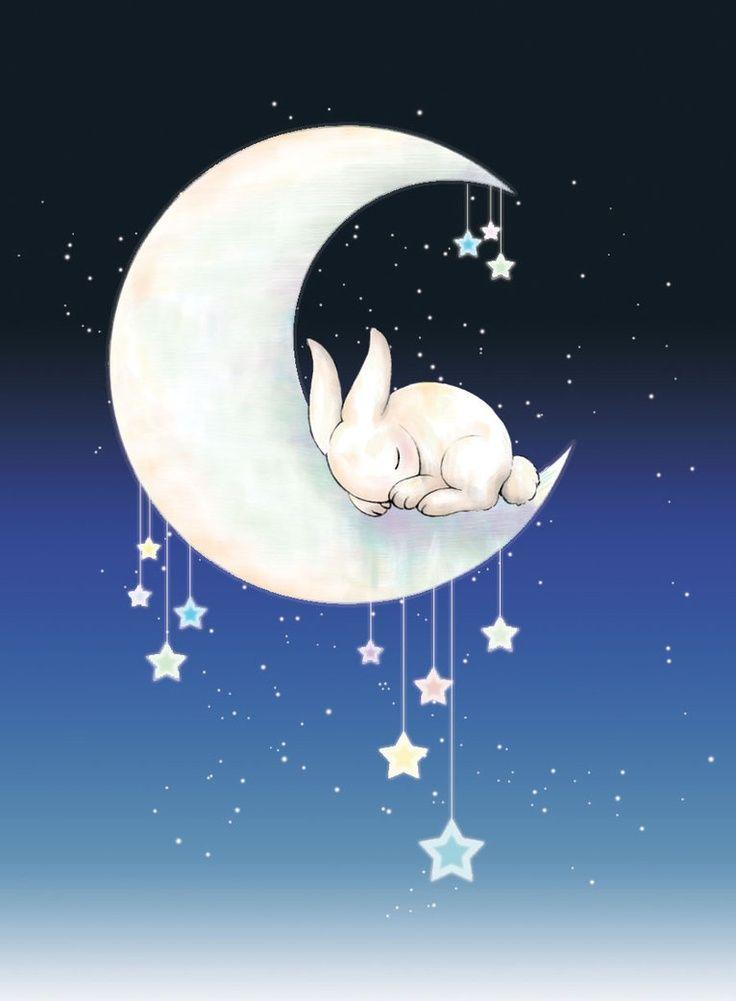 Фото Белый кролик спит на месяце, с которого свисают ...