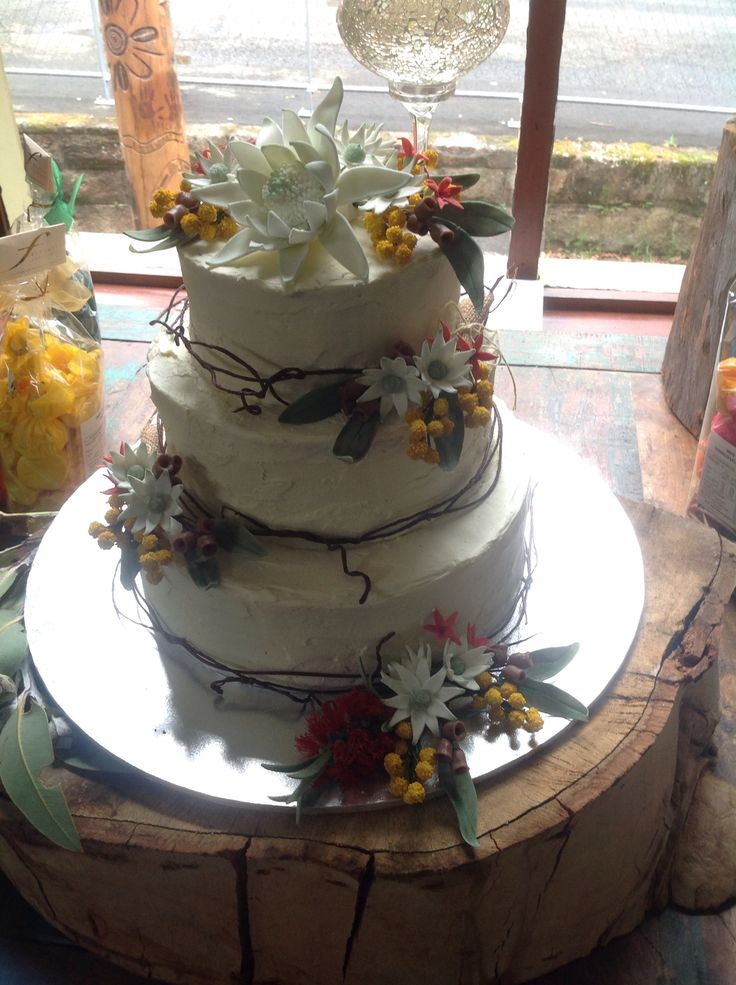 Wedding Cake for my niece. Australian native flowers all made from sugar modelling paste, white Waratah, Flannel flowers, Wattle, Bottlebrush, Christmas bush, Gum leaves & Gum nuts. White chocolate ganache & twisted wire embellishment.