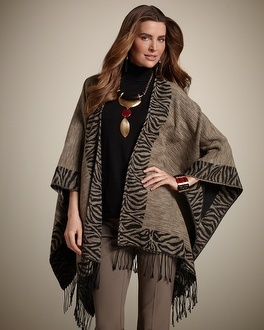 Chico's Ruana.  reversible, packs small and looks great with most anything.  Who needs a blazer with this beauty?