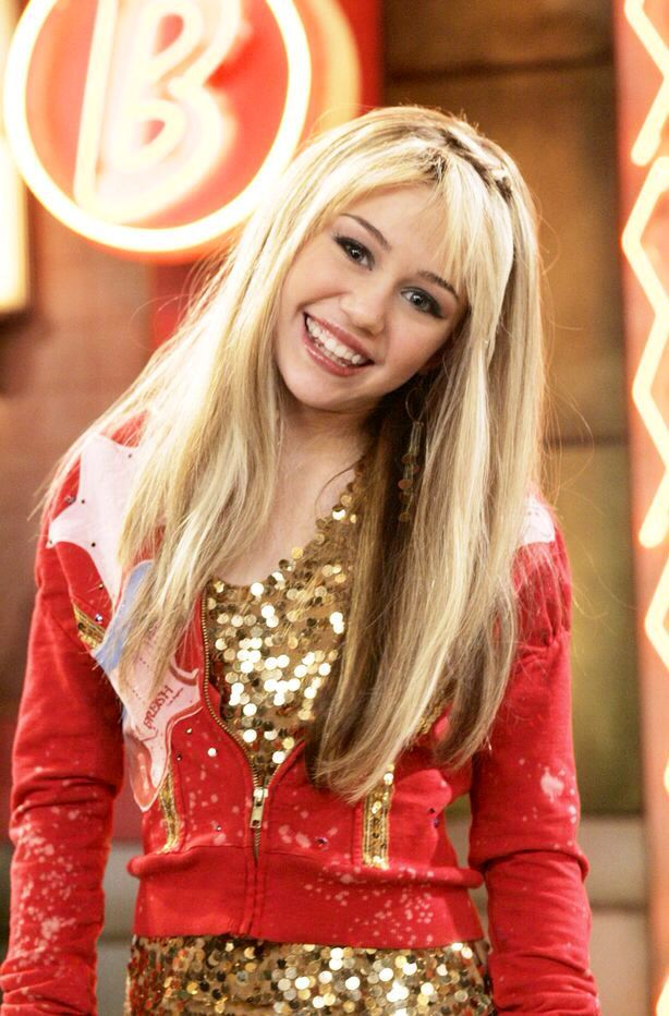 Miley Cyrus as Hannah Montana  She was so pretty back then. /: omg that shows on right now its been along time!!