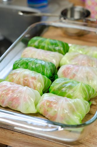 Cabbage rolls stuffed with ground beef, onion, rice, and tomato sauce.