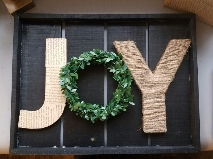 Joy DIY wall hanging! 😍  Stained wood tray from hobby lobby, pressed board letters from Hobby Lobby, twine and newsprint from an old 1800s book. Boxwood wreath garland from Target.  Whole project cost under $10. 😍