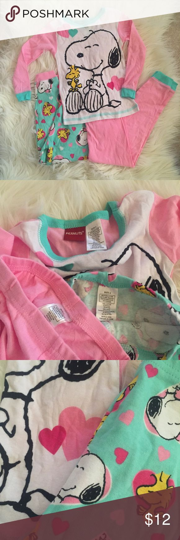 3-Piece Snoopy Pajamas Set Adorable 3 piece Snoopy pajamas set by Peanuts. Size 4. Long sleeved top and two long johns. Hope you enjoy ❤️ NOT Hanna Andersson -- just for visibility! Hanna Andersson Pajamas Pajama Sets