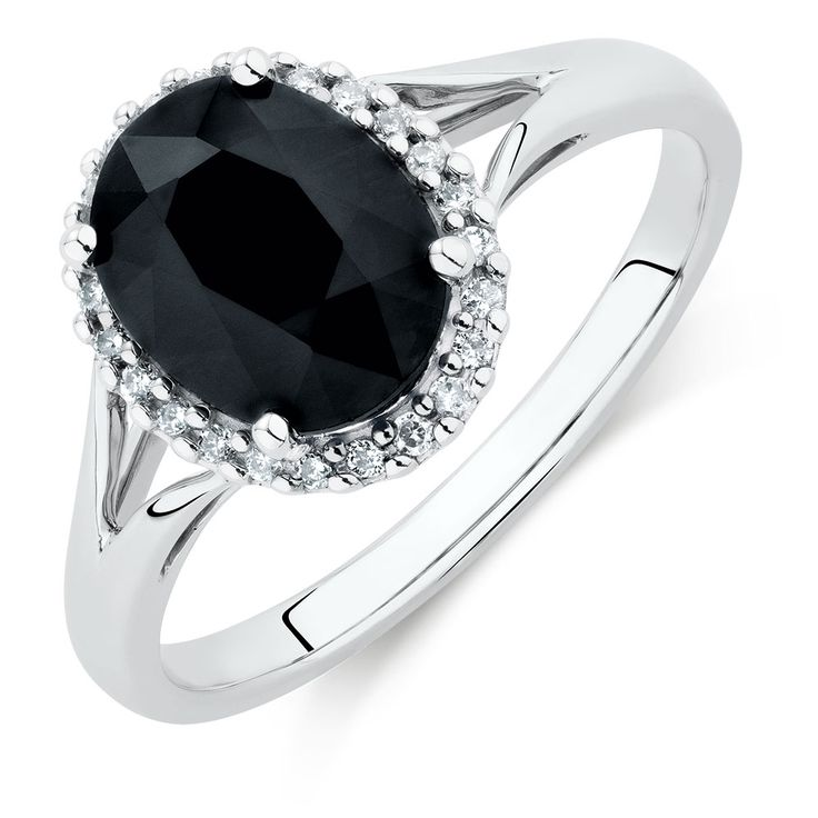 Create contrast with this striking 10kt white gold ring. Centred with a black sapphire and surrounded with a glittering diamond set halo, this monochromatic ring is a timeless choice.